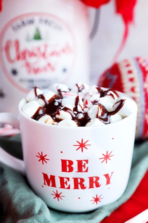 Side image of Be Merry mug with marshmallows