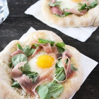 Prosciutto and Arugula Pizza with Sunny Side Up Egg