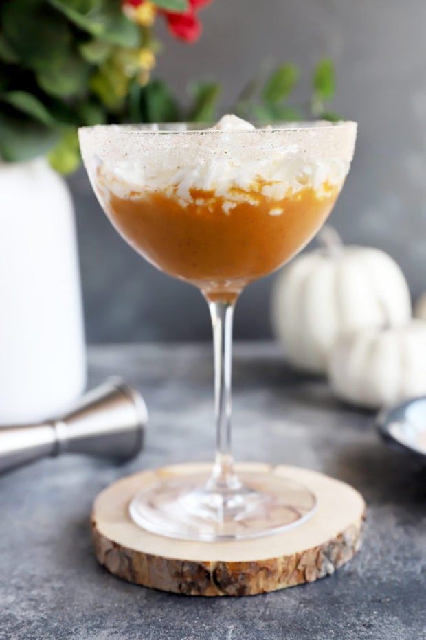 Side photo of pumpkin martini with pumpkins