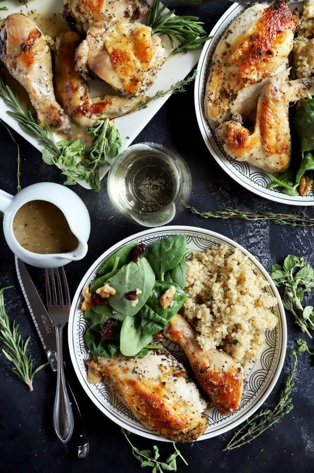 Chicken served on a plate with salad and quinoa