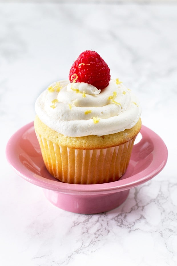 Lemon Raspberry Filled Cupcakes with White Chocolate Buttercream Frosting | cakenknife.com