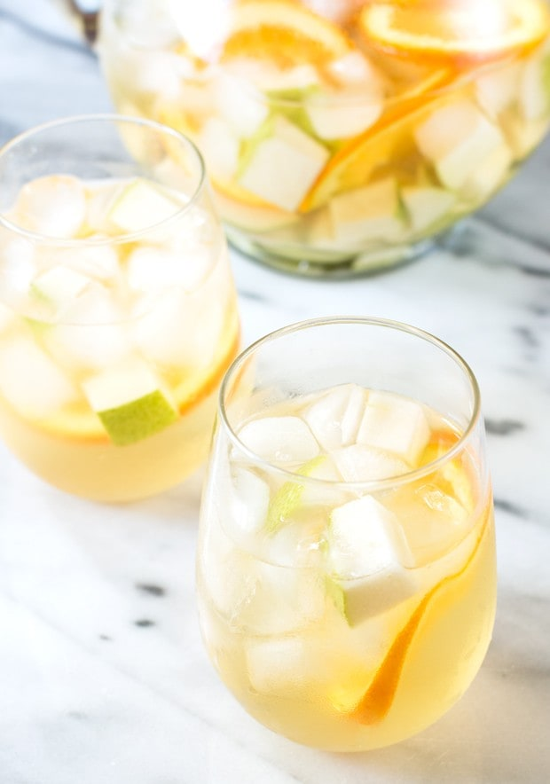 White summer sangria in wine glasses with ice