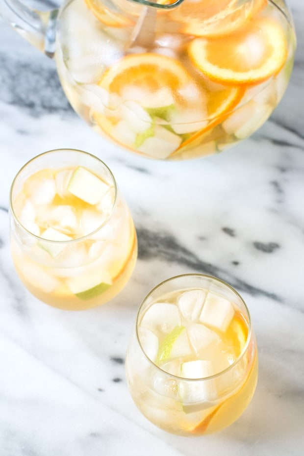 Sangria with pears and oranges in wine glasses