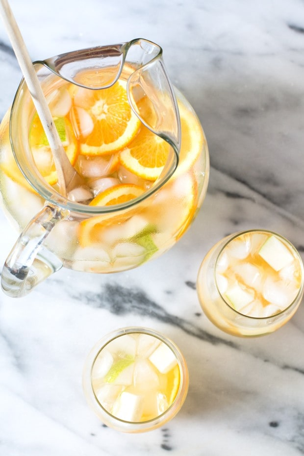 Summer white sangria with oranges and pears