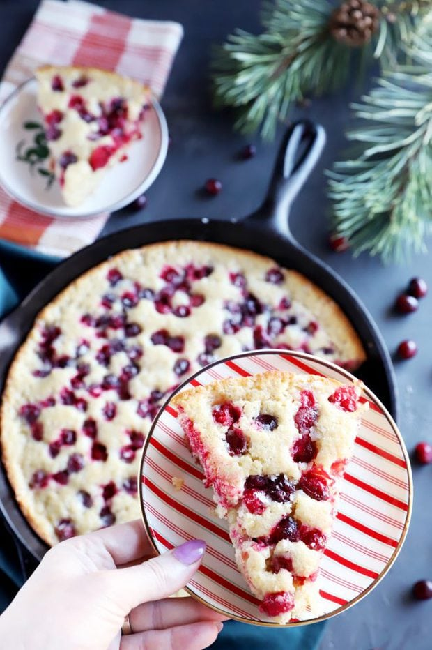 Holiday dessert slice with cranberries on a plate image