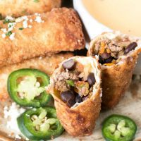 Loaded Nacho Egg Rolls with Queso Dip