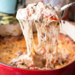 Spicy Lasagna Dip is packed with tomatoes, cheese, herbs and spicy Italian sausage. You won't miss the noodles at all! | cakenknife.com