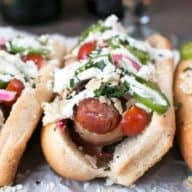 Spicy Bacon-Wrapped Bratwurst with Homemade Pickled Red Onions   cakenknife.com #bratwurst #hotdog #summer #bacon
