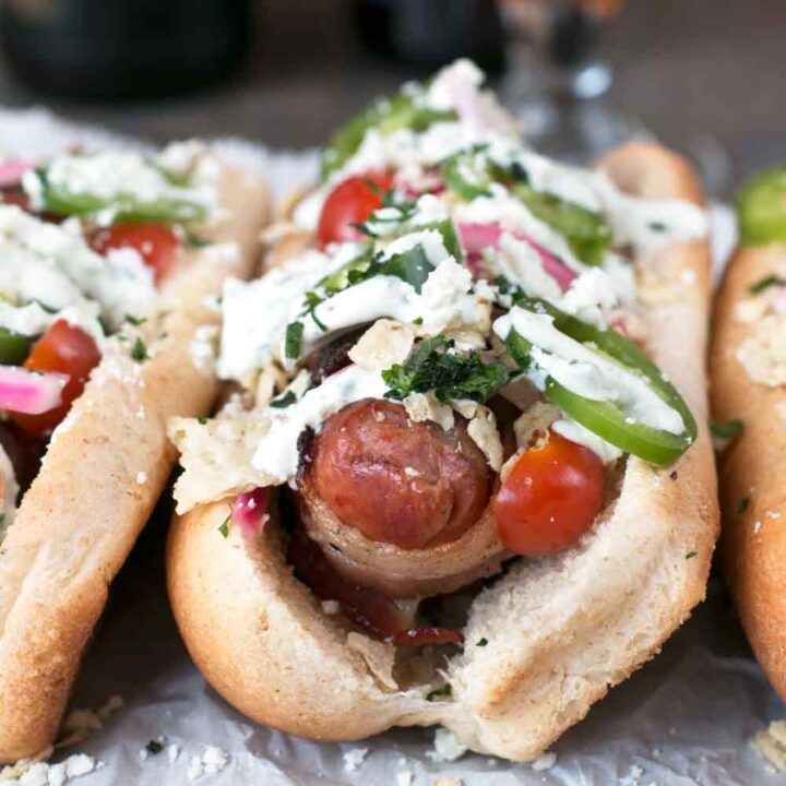 Spicy Bacon-Wrapped Bratwurst with Homemade Pickled Red Onions | cakenknife.com #bratwurst #hotdog #summer #bacon