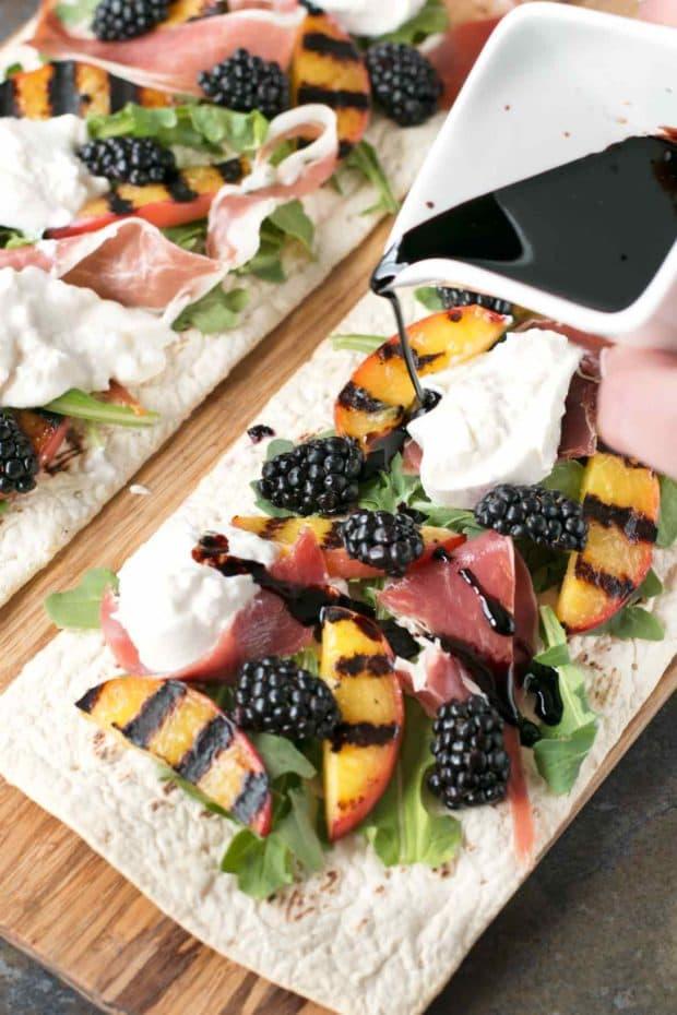 Grilled Peach Prosciutto Flatbread with Blackberry Balsamic Drizzle | cakenknife.com #flatoutflatbread #pizza #appetizer