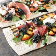 Grilled Peach Prosciutto Flatbread with Blackberry Balsamic Drizzle | cakenknife.com #flatoutflatbread #pizza #appetizer