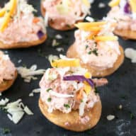 Bang Bang Shrimp Tostada Bites with Mango Slaw | cakenknife.com #appetizer #party #bangbangshrimp