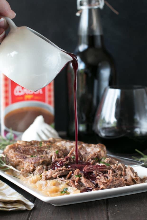 Slow Cooker Garlic Rosemary Pot Roast with Red Wine Sauce | cakenknife.com #ad #roastwiththemost #potroast #crockpot