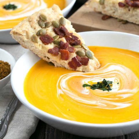 Curried Roasted Butternut Squash Soup with Bacon Pumpkin Seed Bread