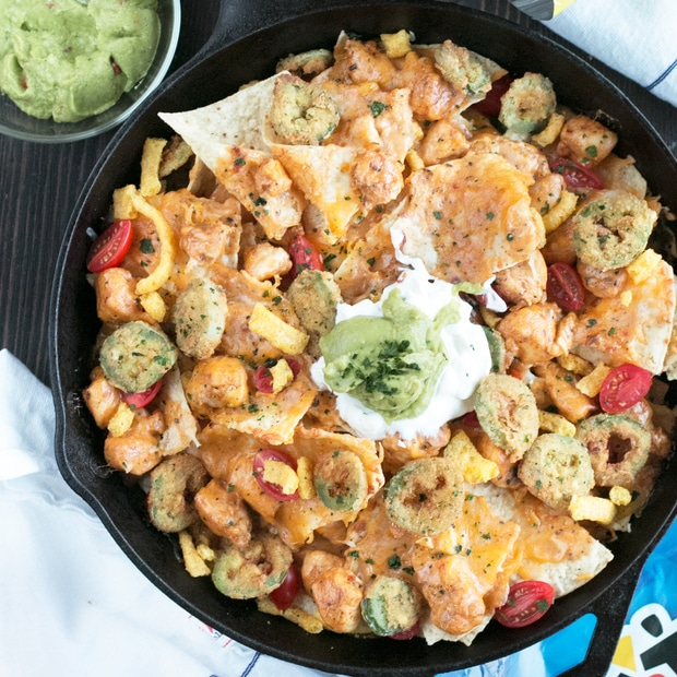 Triple Layer Chipotle Chicken Queso Nachos with Fried Jalapeños - Cake 'n Knife