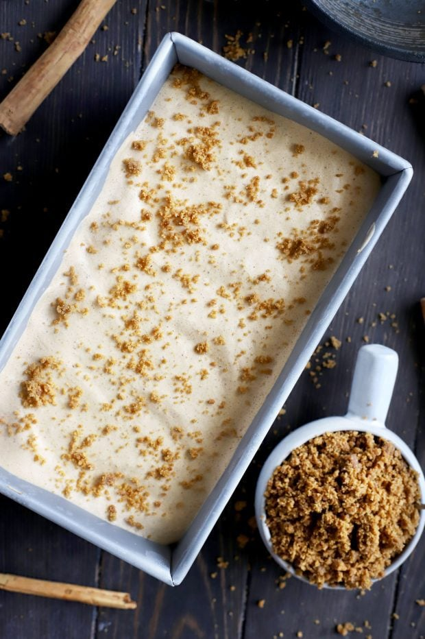 Pumpkin Spice Latte Ice Cream in a pan with Gingersnap Crumble on the side