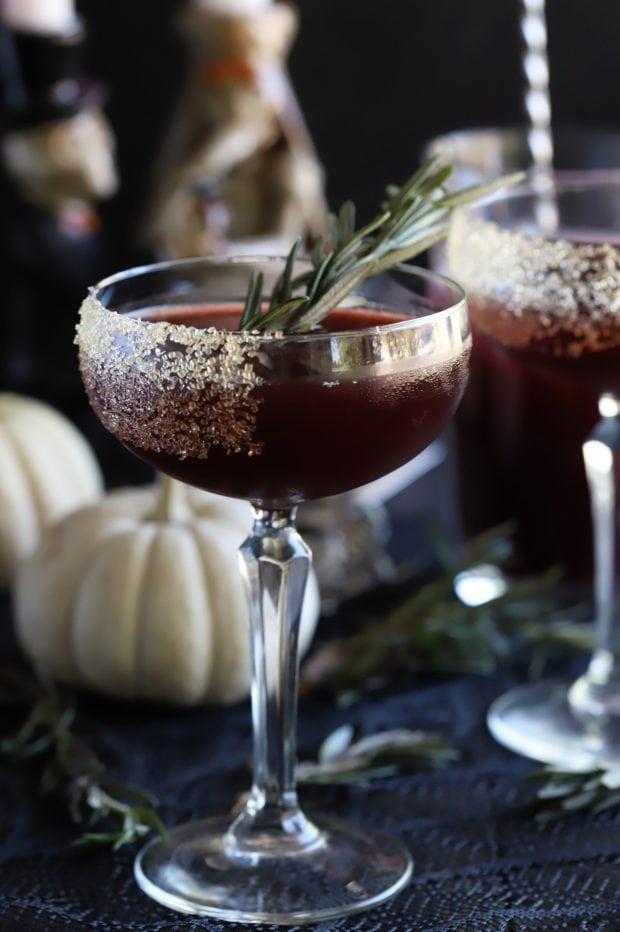 Spooky Pomegranate Mezcal Cocktail with pumpkins
