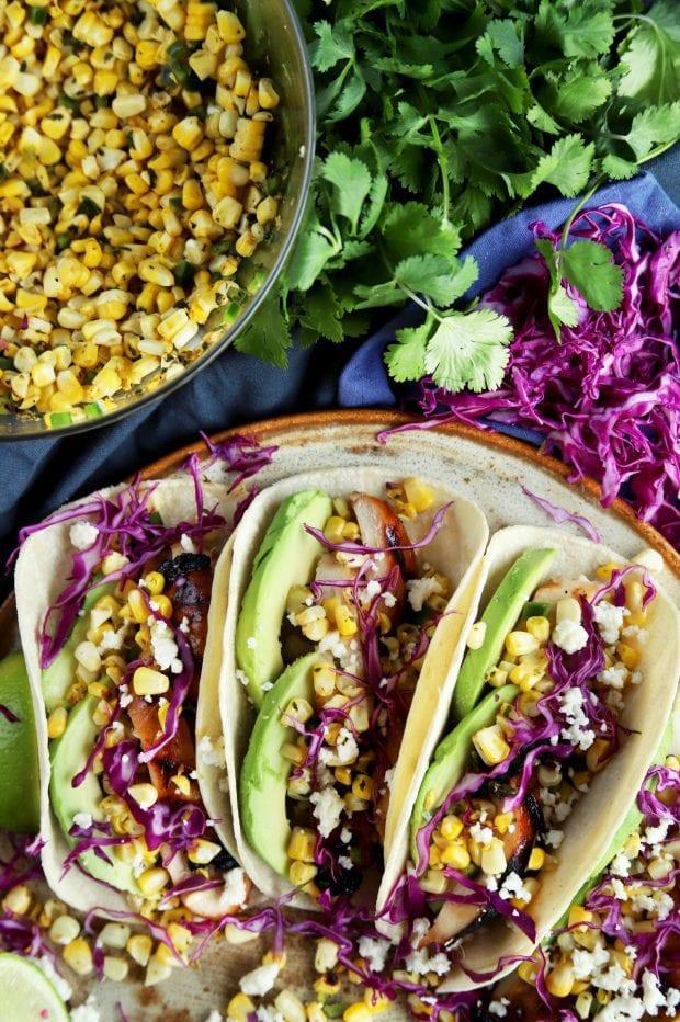 Charred Corn Chicken Avocado Tacos on a platter