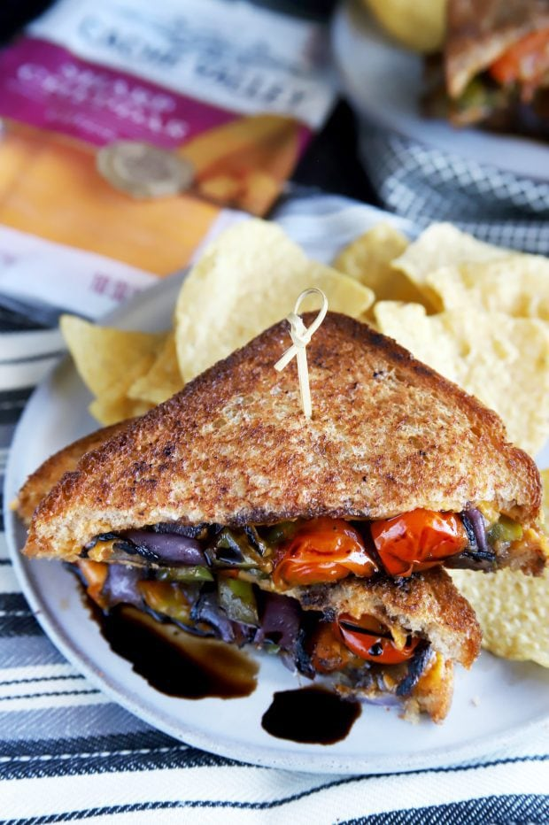 Gourmet grilled cheese sandwich with chips