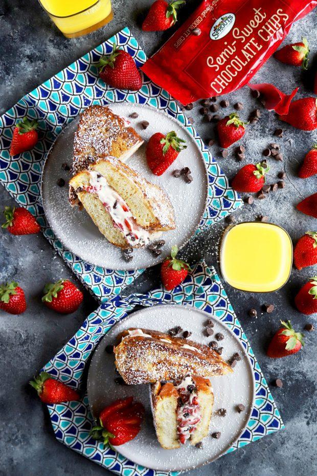 Fresh strawberries, chocolate, and orange juice with French toast