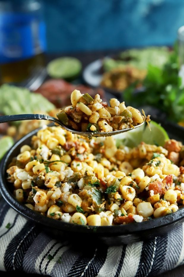 A spoonful of grilled corn salad