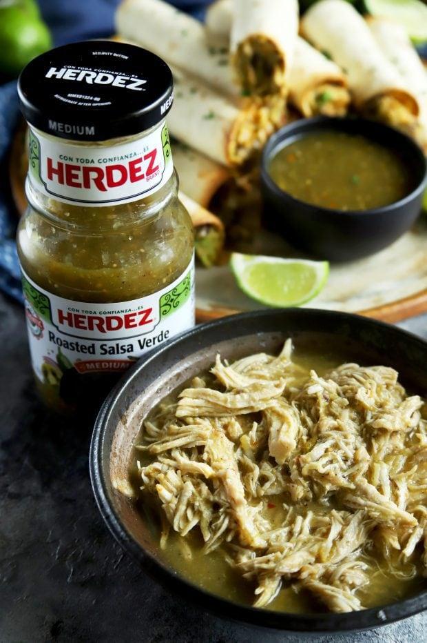 Salsa verde chicken with a bottle of HERDEZ salsa
