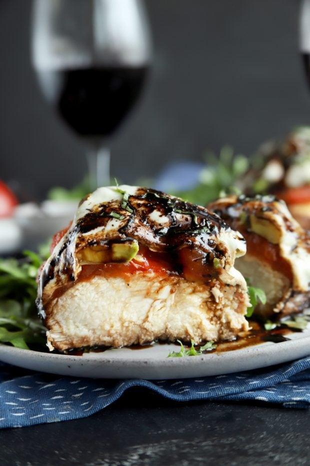 Avocado caprese chicken cut in half for dinner