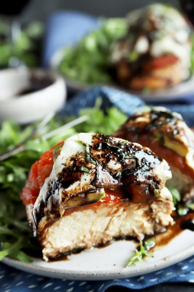 Caprese chicken cut in half