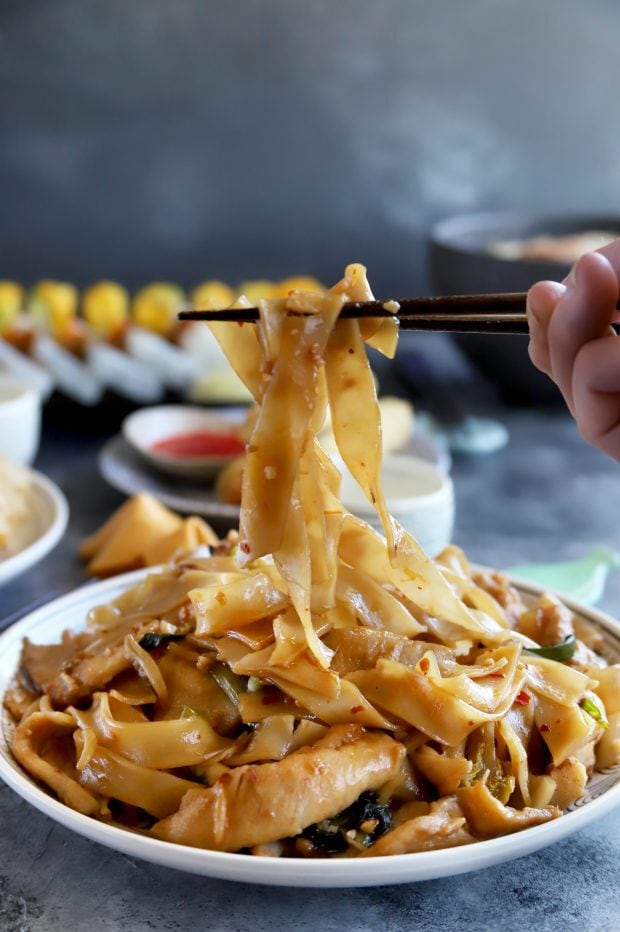 Lifting out Pad Thai noodles from a plate
