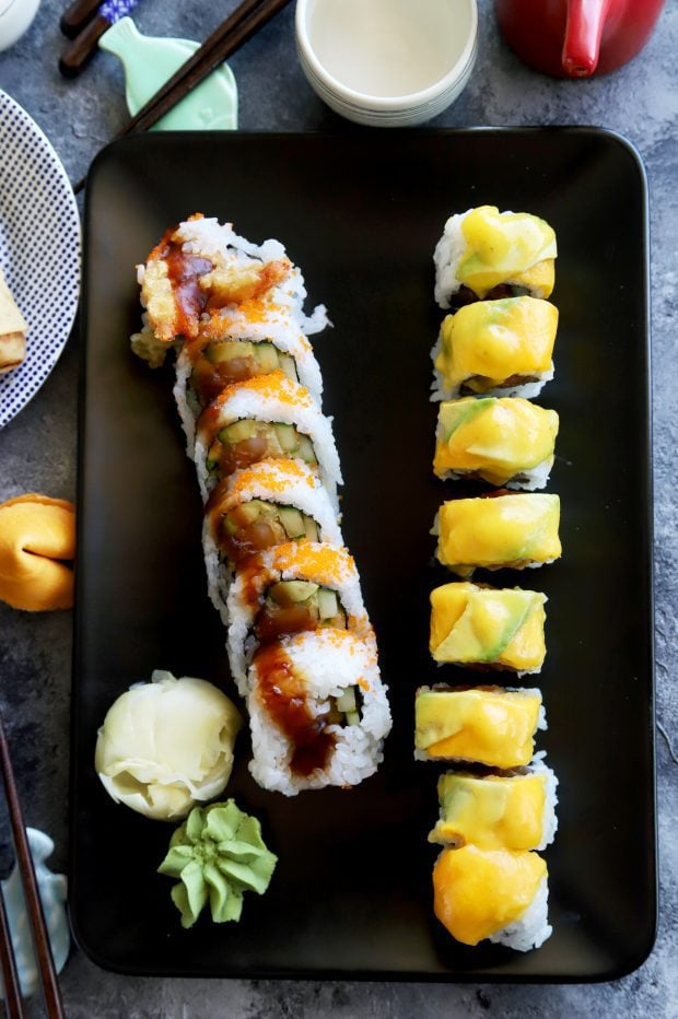 Sushi rolls on a plate with wasabi and ginger