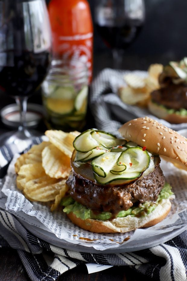 A miso glazed sriracha burger topped with pickles