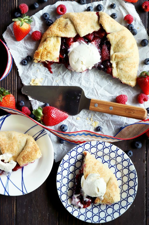 Sliced up berry galette with ice cream