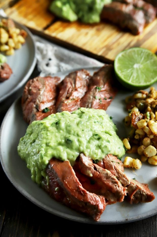 Pieces of flank steak with salsa and corn salad