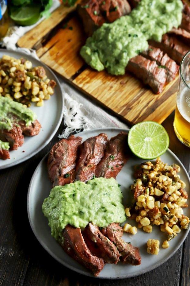 Steak dinner with avocado salsa and corn salad