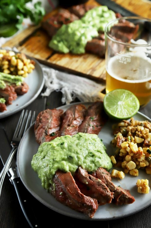 Sliced steak with beers and corn salad