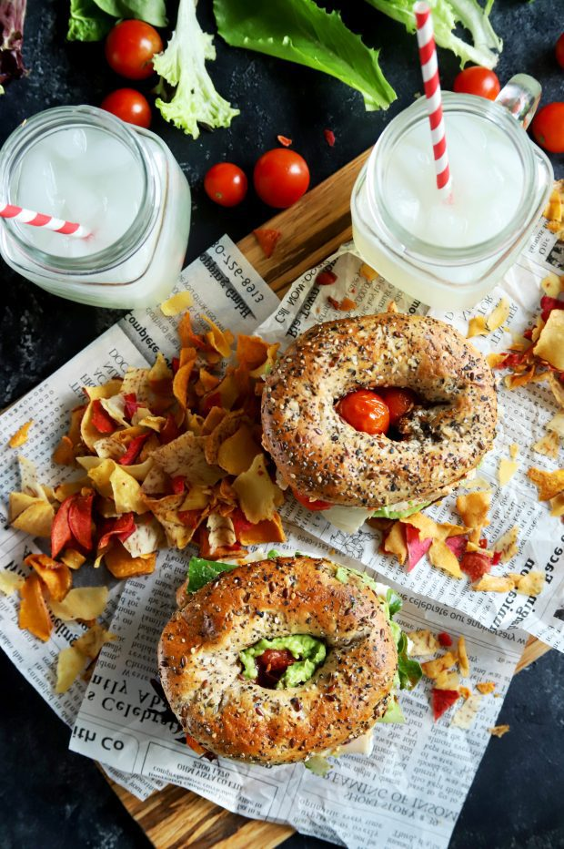 Bagel sandwiches and chips with lemonade