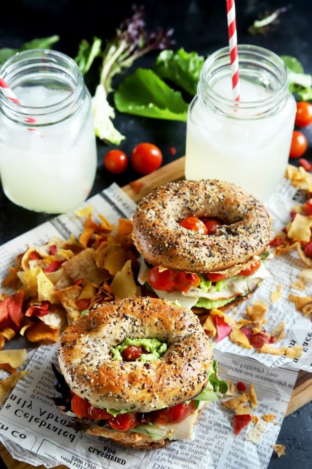 Sandwiches for a picnic with lemonade and chips