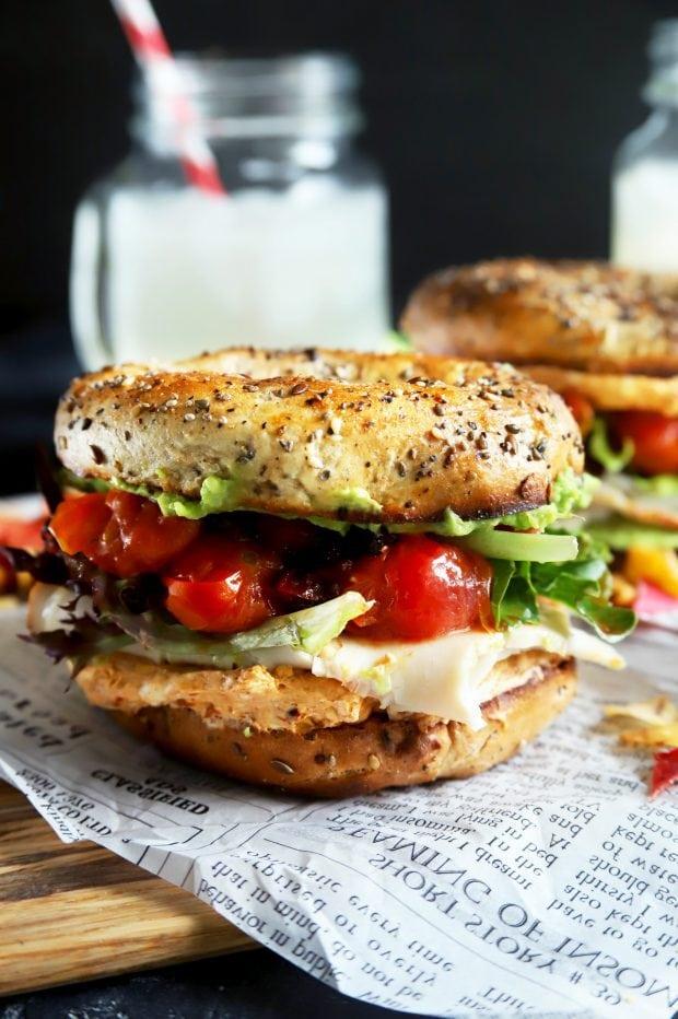 Stacked turkey bagel sandwich