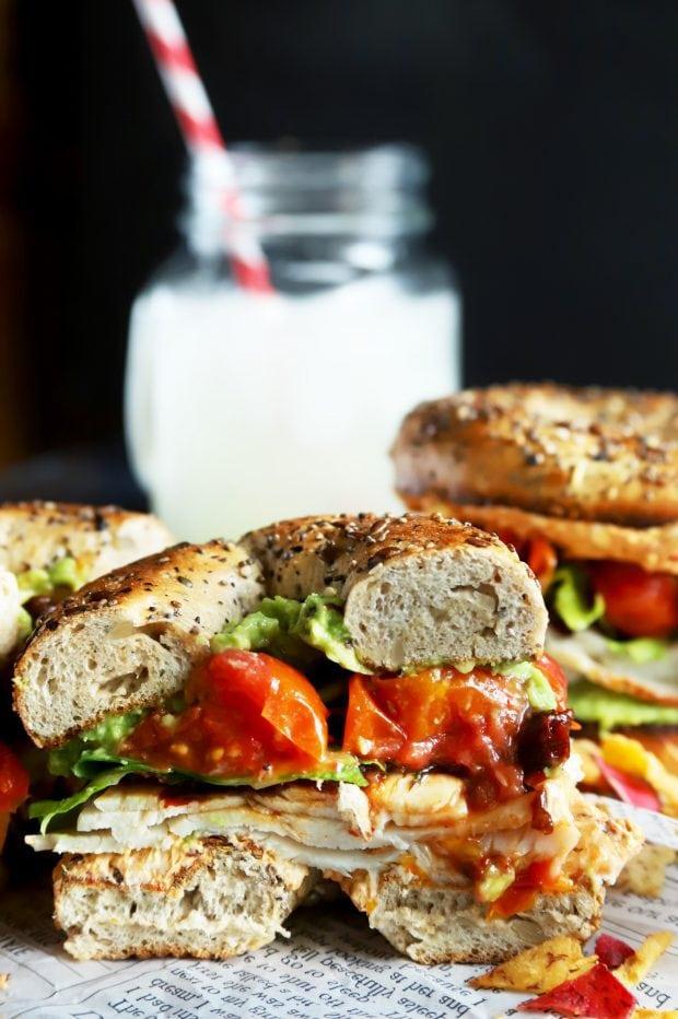 Half of a vegetable bagel sandwich