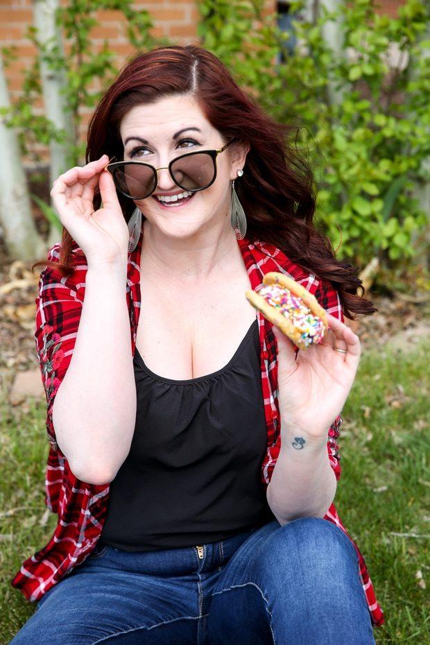 Woman holding an ice cream sandwich outside