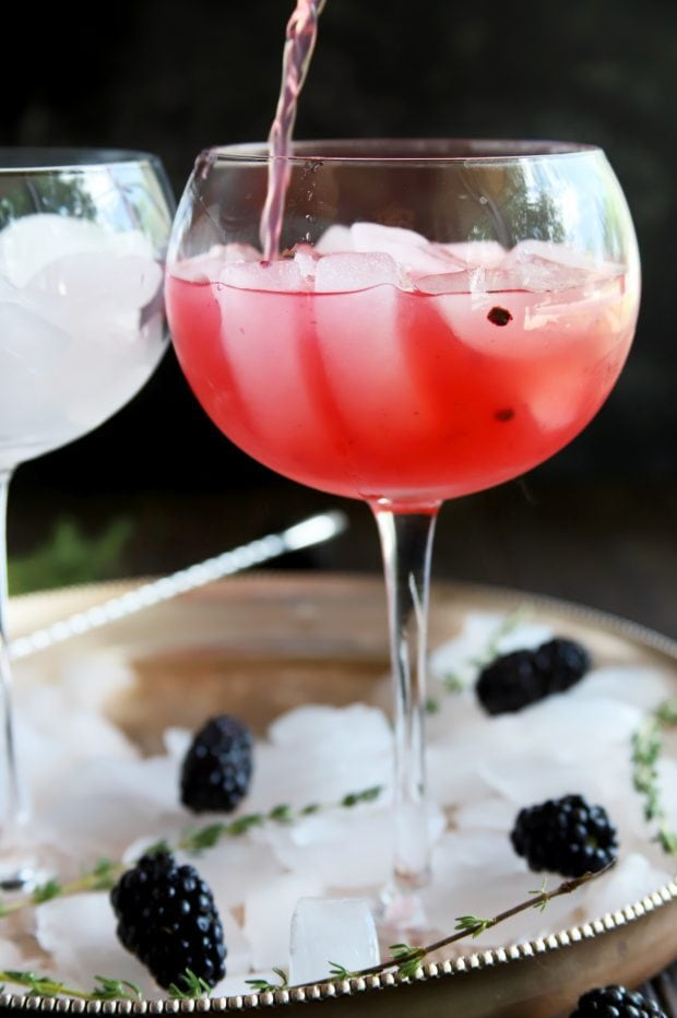 Pouring a blackberry gin and tonic