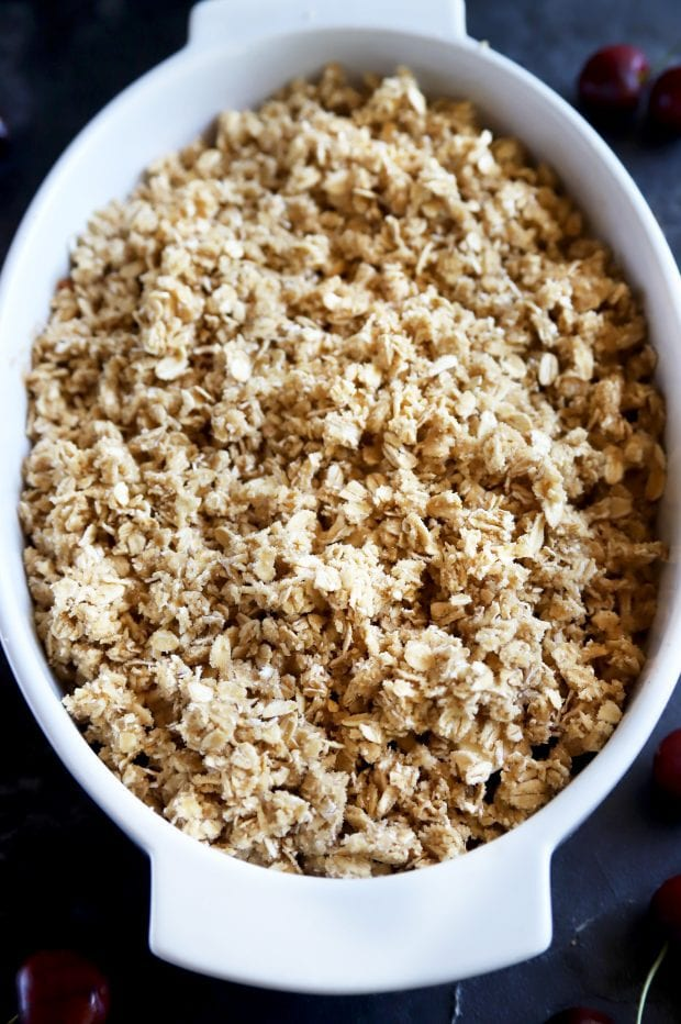 crumble topping in a baking dish before baking