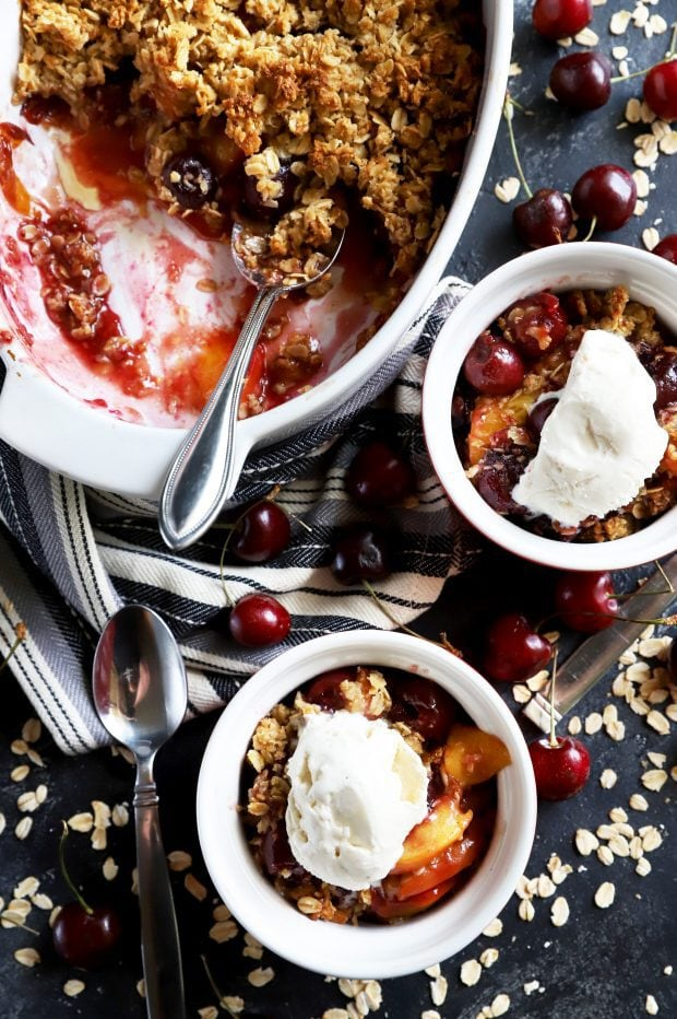 Bowls of summer fruit crumble and ice cream