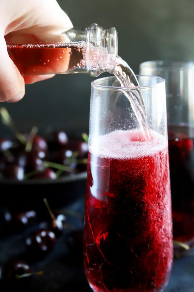 Pouring in sparkling rose into a champagne flute