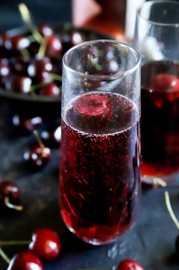Cherry red mimosa with fresh cherries and rose