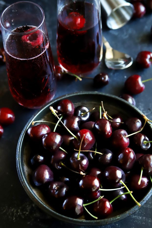 Overhead shot of a bowl of fresh red cherries