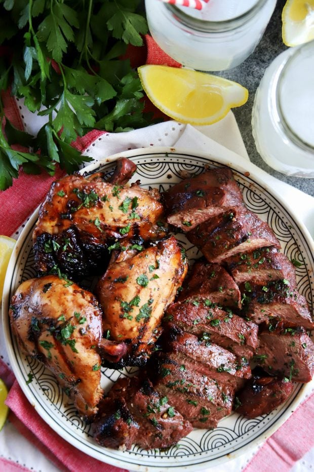 Grilled chicken and steak on a plate