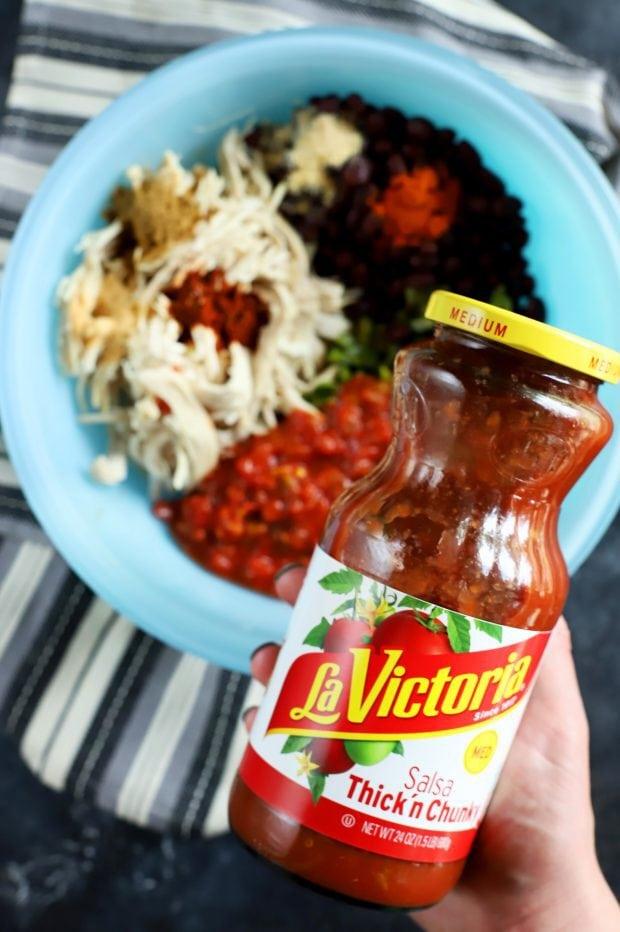 Adding salsa to the filling for empanadas