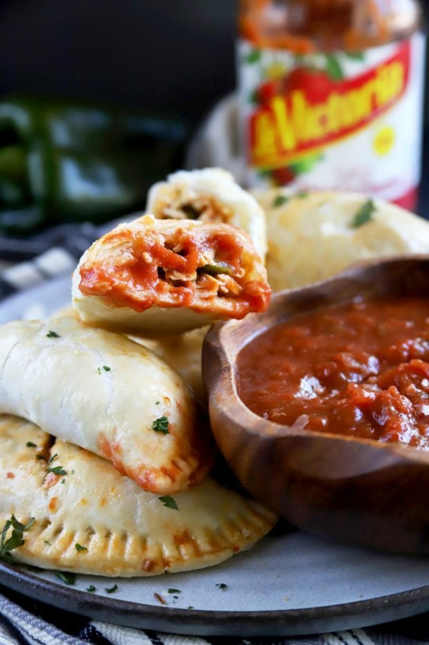 Mexican empanadas dipped in salsa