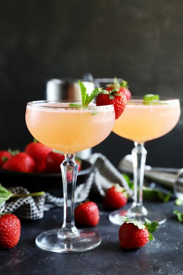 Fruit and herbs in a cocktail with coupe glasses